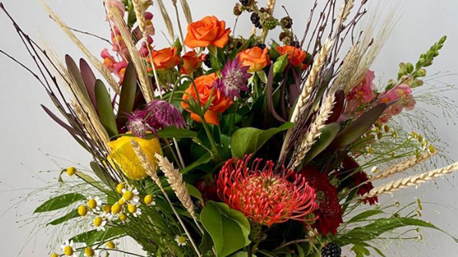 Floral Arrangement in a Willow Vase slider